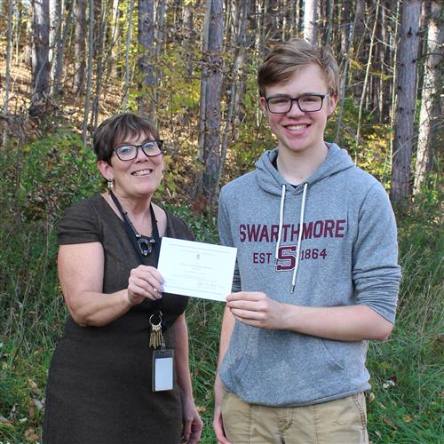 Nathan ReceivesNational Merit Scholarship Letter of Commendation  from Mrs. Bain-Lucey
